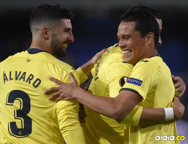 Carlos Bacca festejando el gol que anotó el jueves en los octavos de final de la Liga de Europa ante el Zenit.AFP