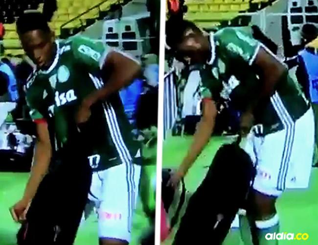 Momento en que Mina intentaba sacar el trípode del maletín durante la pelea en Uruguay   Capturas