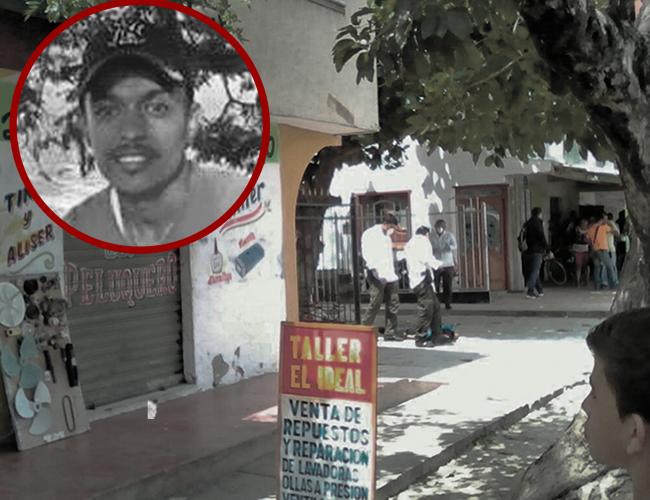 El cadáver del empleado quedó tirado en la calle. Trató de detener a los asaltantes. | Foto: Archivo