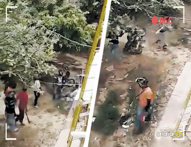Capturas del video que registró el hecho. Se ven armas y cuando uno de los sujetos tumba una motocicleta. | AL DÍA