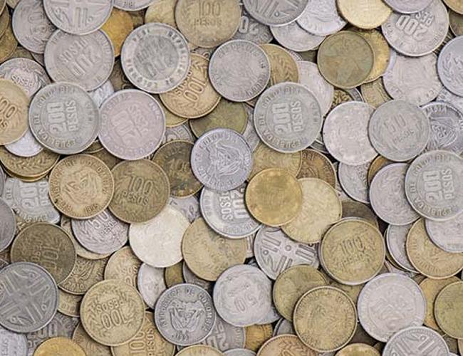 Las monedas de $100, $200 son las de menor denominación en Colombia   Foto: Archivo